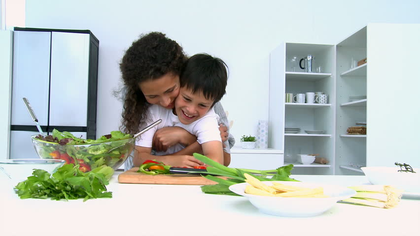 Mother Cooking A Salad With Her Son In The Kitchen Stock Footage Video 1005166 Shutterstock