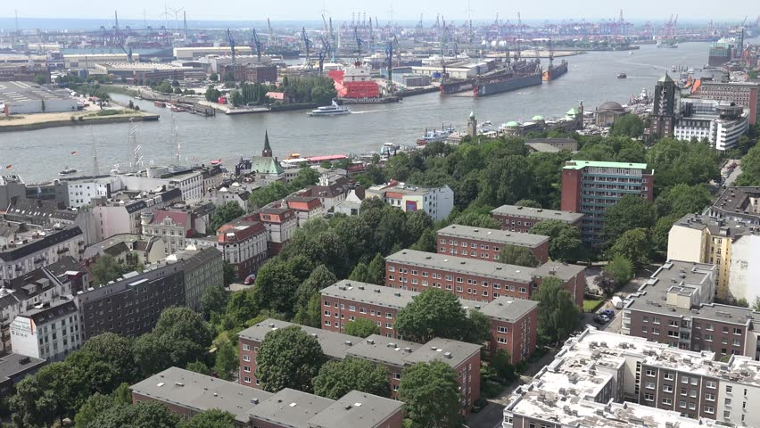 HAMBURG - GERMANY, JULY 7, 2014, ULTRA HD 4K Aerial view of old port with industrial crane and cargo ship by day - 4K stock footage clip