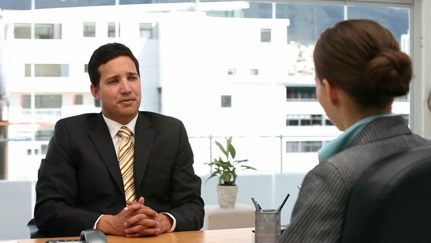 Interview between a businessman and a woman in his office