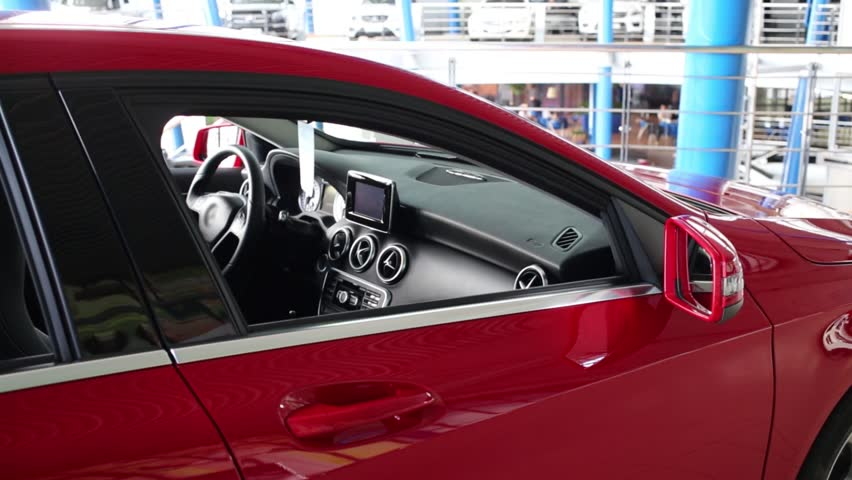 Beautiful new shiny red car with opened window in big store | Shutterstock HD Video #10068701