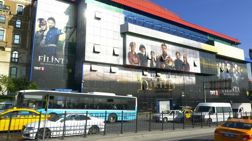 ISTANBUL - MAY 4, 2015: TRT Tepebasi Studios Building on Tarlabasi Boulevard. Building covered with Filinta soap opera posters, 400 people work in each episode, made with a budget of over $1 million