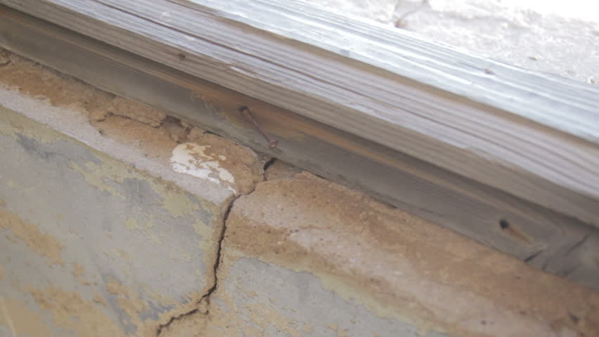 Crack in the wall of an abondoned house in ghost town Kolmanskop, Namibia