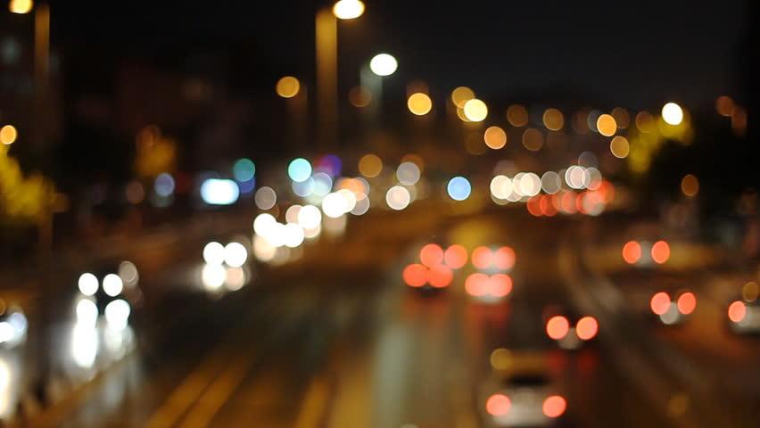 Defocused Background Of City At Night. Bokeh Sparkling Car ...  Defocused Backg...