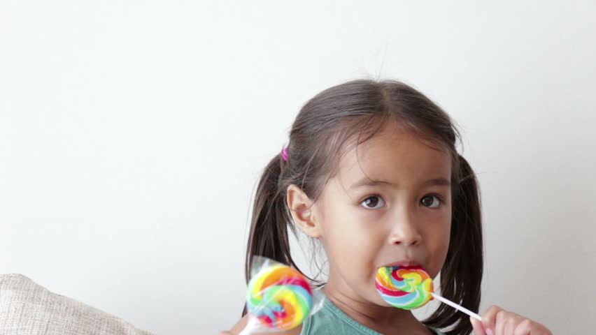 happy little girl with lollypop sweet candy