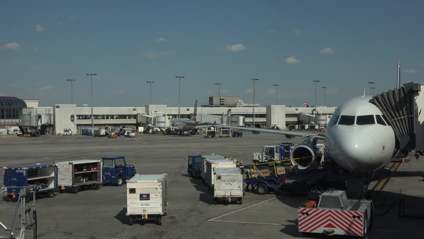 WASHINGTON, DC - APR 2015: Aircraft empty cargo Dulles International Airport ramp 4K. Busiest airport in Washington metropolitan area. 21.6 million passengers in 2014. Business and vacation travel.