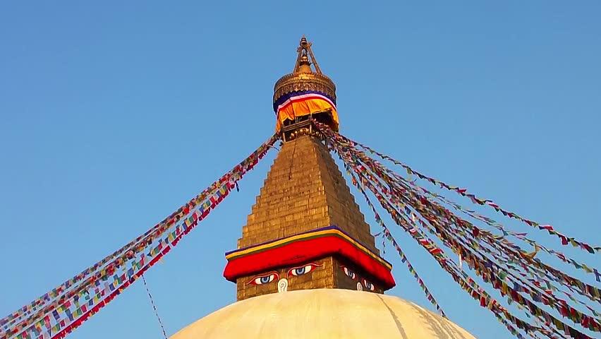 KATHMANDU, NEPAL - NOVEMBER 2: The Boudhanath Stupa just before sunset on November 2, 2013 in Kathmandu, Nepal. The stupa survived the massive earthquake of 25 April, 2015. - HD stock footage clip