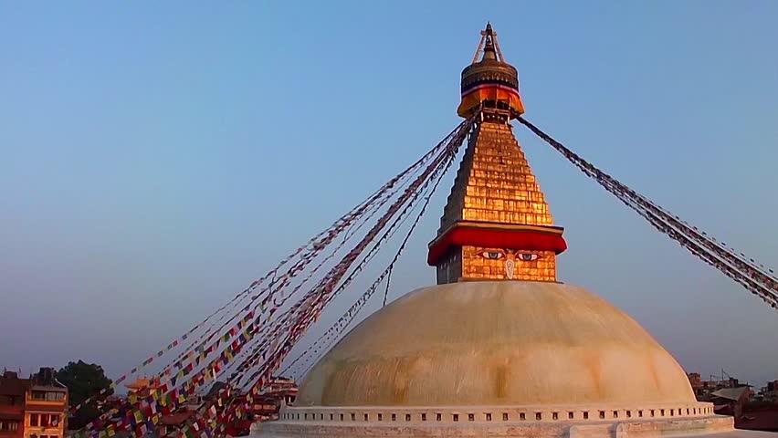 KATHMANDU, NEPAL - NOVEMBER 2: The Boudhanath Stupa just before sunset on November 2, 2013 in Kathmandu, Nepal. The stupa survived the massive earthquake of 25 April, 2015. - HD stock video clip