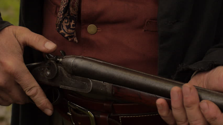 VIRGINIA - 2014. Re-enactment recreation of classic Old West, 1800s Western gunfight, and Killing. Cowboys and Outlaws. 1870-1890 western life. Guns and shootouts. OK Corral. Tombstone. - HD stock footage clip