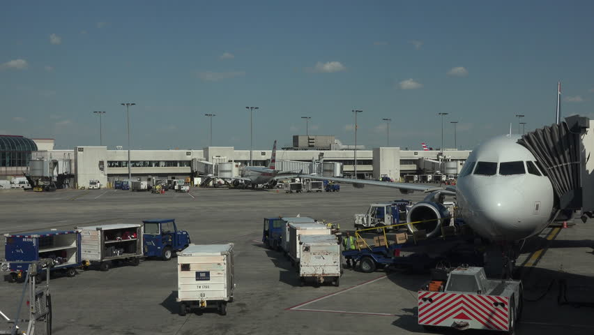 WASHINGTON, DC - APR 2015: Aircraft empty cargo Dulles International Airport ramp fast 4K. Busiest airport in the Washington metropolitan area. Served over 21.6 million passengers in 2014. Busy ramp. - 4K stock video clip