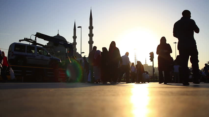Square with people walking around Eminonu Mosque in Istanbul City. Time Lapse. Stop motion urban scene during sunset.