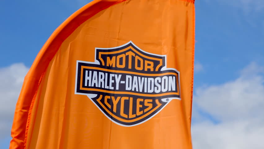 NOVOSIBIRSK, RUSSIA, MAY 23, 2015: holiday Harley-Davidson - Big Test Ride. Motor Harley Davidson Cycles orange flag waving on the wind against blue sky. - HD stock footage clip