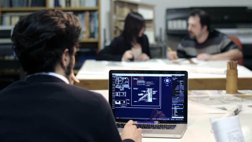 Male architect at work with a cad software on a laptop for Architect at work