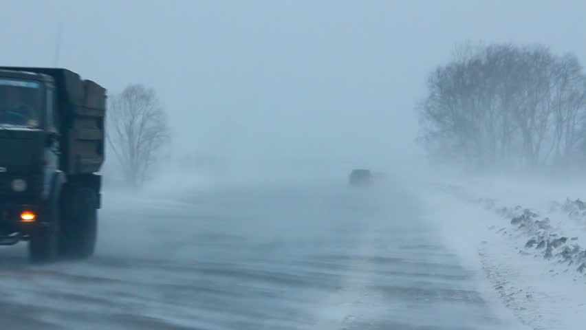 cars on winter road during blizzard - HD stock footage clip