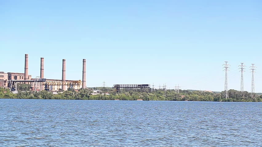 A Coal-fired Power Station In River Landscape With Dead Trees ...