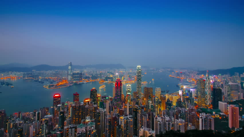 Blue hour time-lapse of Hong Kong, seen from The Peak and depicting Central, Admiralty, Wan Chai, Causeway Bay, Kowloon and Tsim Sha Tsui
