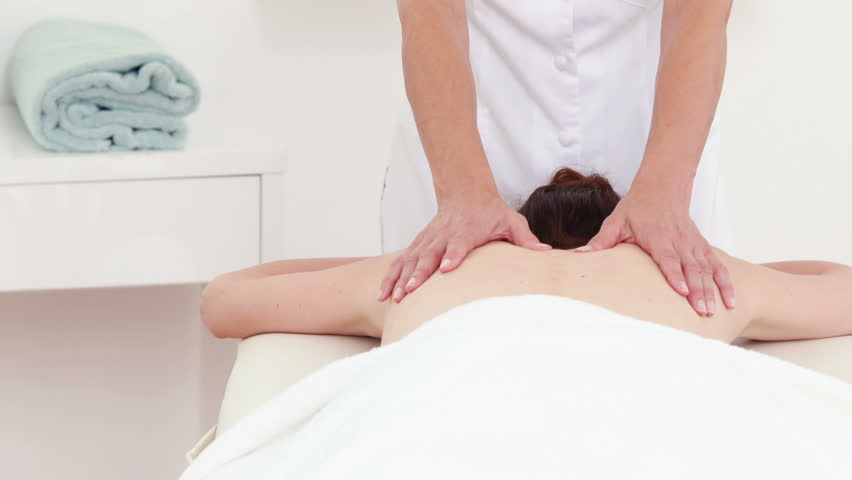 Physiotherapist doing back massage to her patient in medical offfice - HD stock video clip