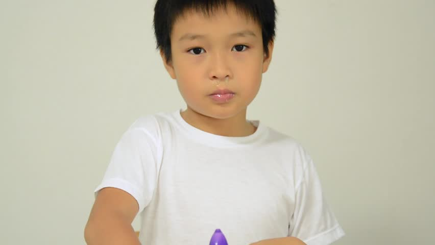 Asian boy wash nasal by inject saline water from plastic bottle for a smooth aspiration