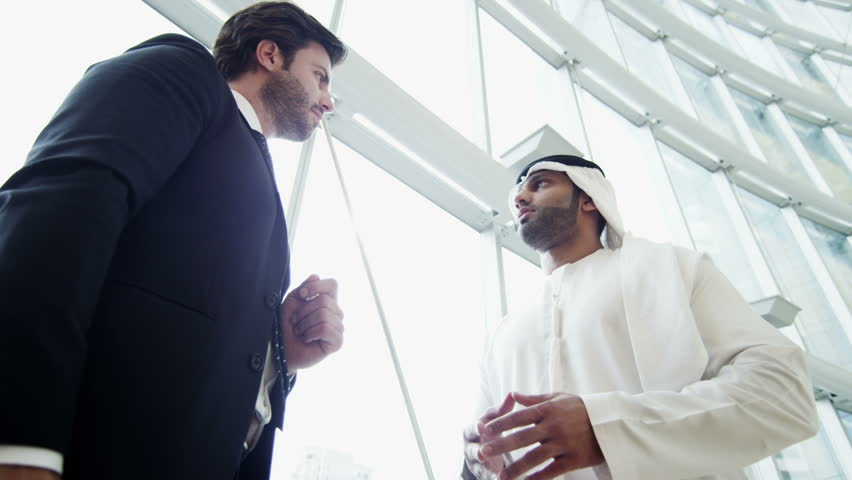 Middle Eastern male American business tablet technology stocks shares trading