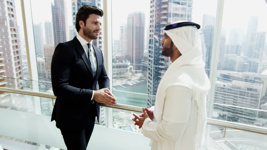 handshake American Arabic business male conference convention meeting travel