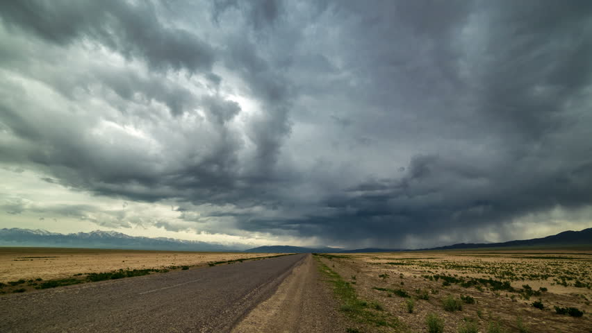 Almaty, Kazakhstan - 15 may 2015: Thunderstorm storm in the desert along the road. 4K TimeLapse. | Shutterstock HD Video #10384142