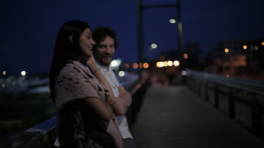 Couple at night outdoors talking happy in city - HD stock footage clip