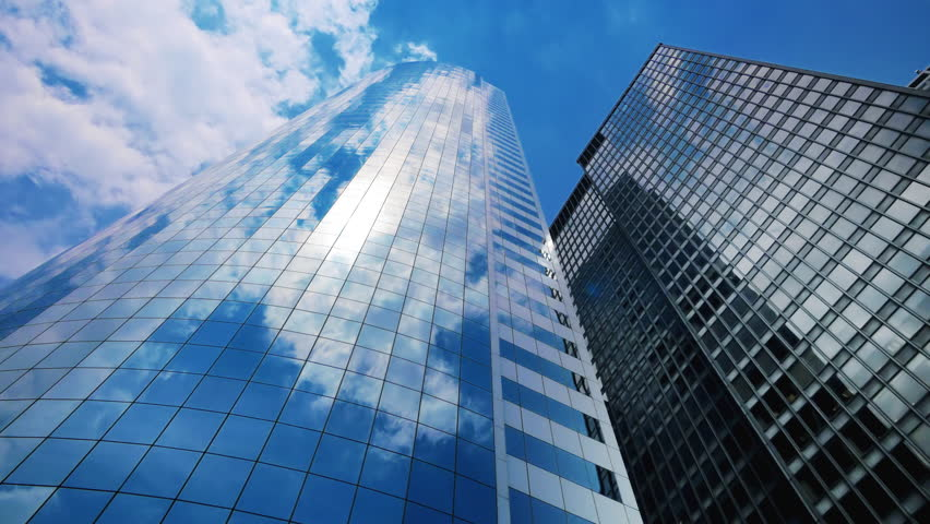 Sky and clouds reflecting over skyscrapers in New York City, time lapse - 4K stock footage clip