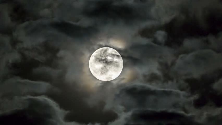 Shot of a bright moon among moving clouds. | Shutterstock HD Video #10453586
