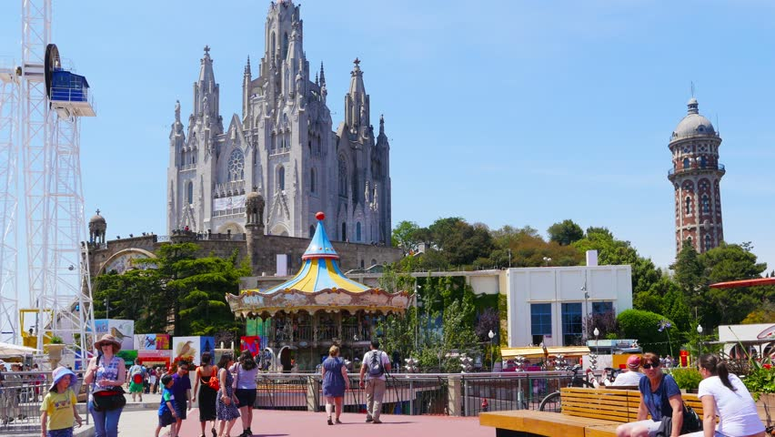 BARCELONA, SPAIN, CIRCA MAY 2015: people with their children visiting attraction park on Tibidabo mountain. - 4K stock video clip