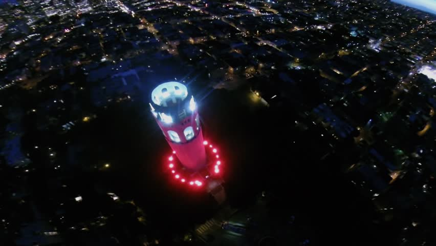 SAN FRANCISCO - OCT 21, 2014: Coit Tower with illumination against megalopolis at evening. Aerial view. Coit Tower, also known as Lillian Coit Memorial Tower. - HD stock video clip