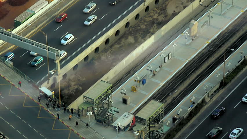 Aerial view of the city Tel Aviv during the afternoon. Train leaving station. - HD stock video clip