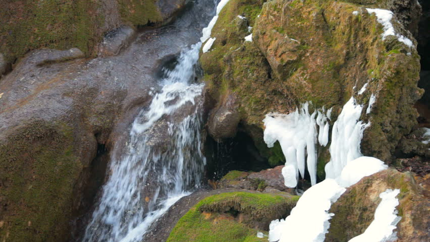 Waterfall Silver stream and mossy rock in winter. Grand Canyon, Crimea, Ukraine - HD stock video clip