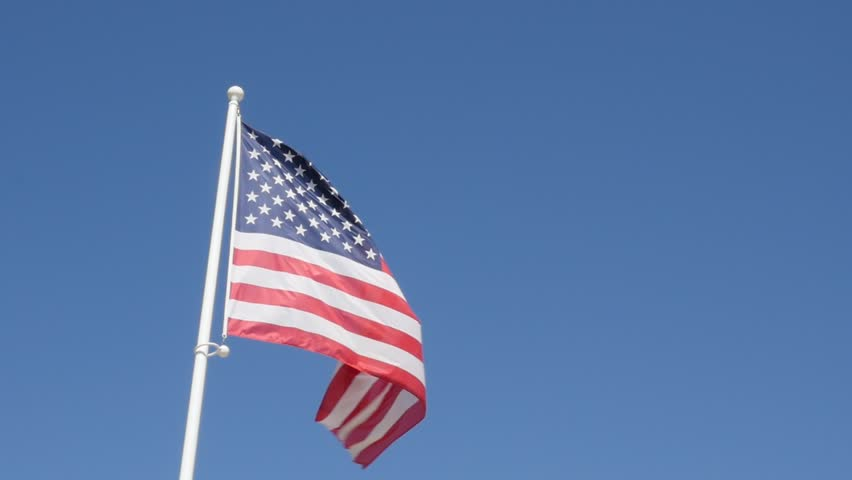 United  States of America flag in front blue sky slow waving on wind 1080p FullHD slow-mo footage - American flag and blue sky slow motion 1920X1080 HD video - HD stock footage clip