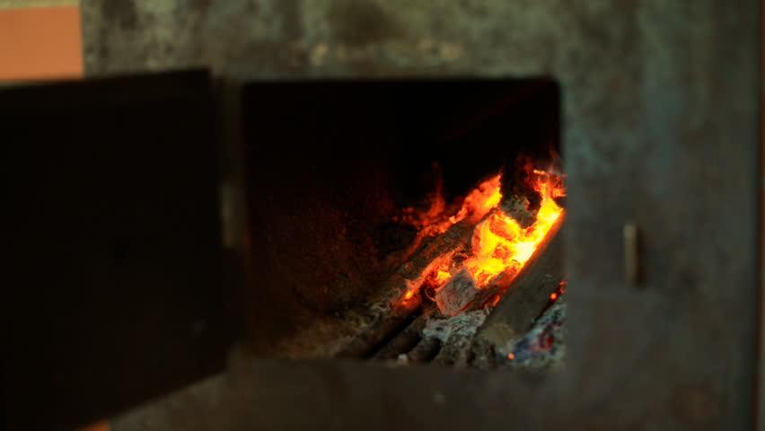 Man heating stove at sauna. - HD stock video clip