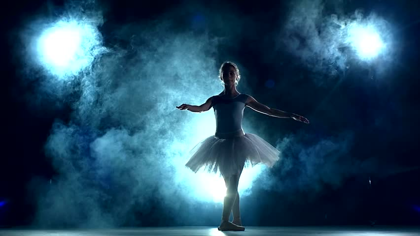 graceful ballerina doing a workout in the classroom. Smoke, fog, silhouette. ballet dancer in white tutu, girl in pointe, whirls around you, slow motion - HD stock footage clip