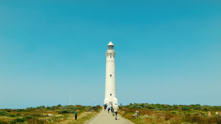AUGUSTA, AUSTRALIA - OCTOBER 2014: Tourists walking down the path to the Cape Leeuwin Lighthouse, on a clear day. - HD stock video clip