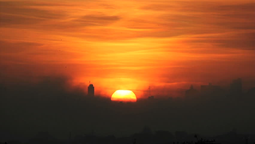 Quite morning. Silhouette buildings and golden sun. Smoke, Warm, pollution