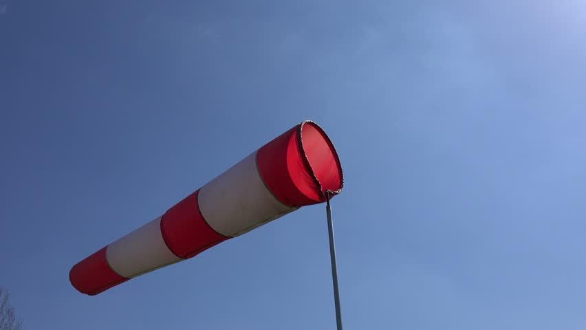 wind sock wave in wind on blue sky background. Static tripod shot. 4K UHD video clip.