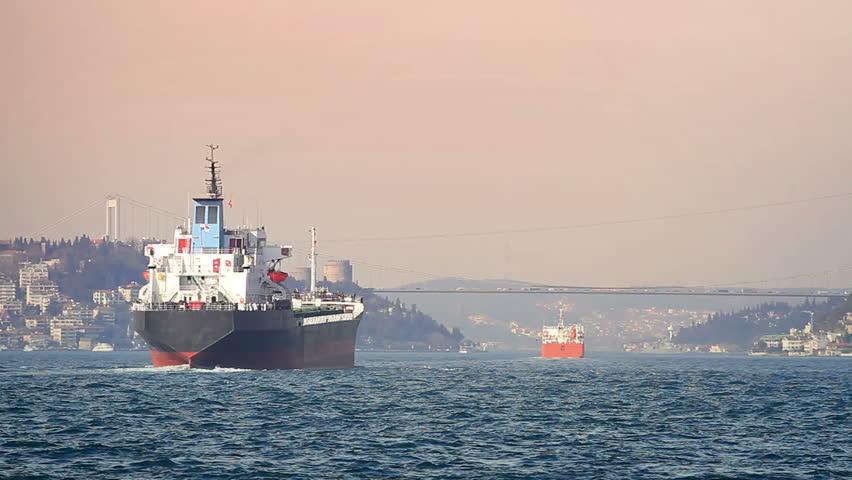 Cargo vessels cruising along Bosphorus Sea at sunset. Istanbul, Turkey