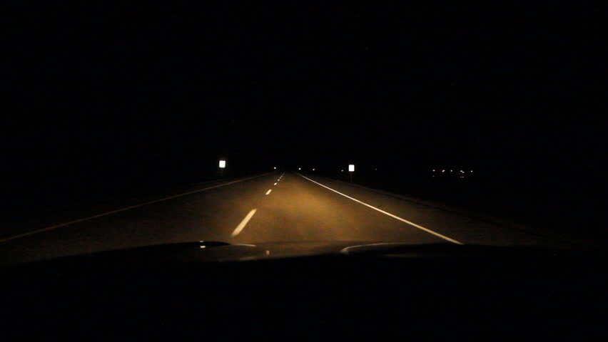 Driving at night on the highway. Alberta, Canada. Driving at night on the TransCanada HWY 1 in Alberta, Canada. Note: As this is a low light shot there is some noise in the clip.