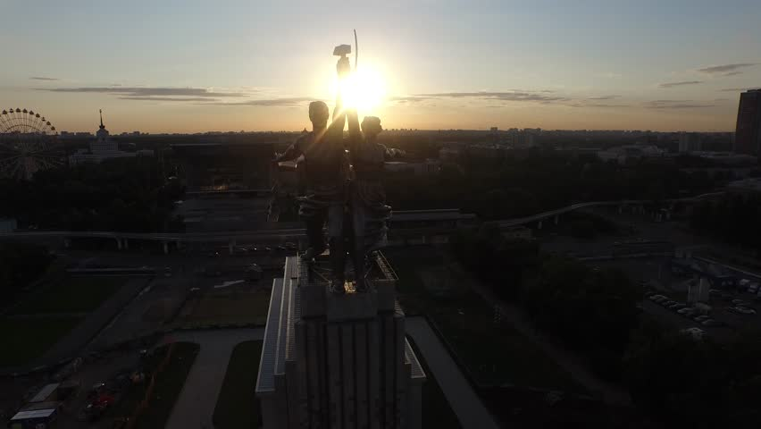 RUSSIA. MOSCOW. JULY 2015: Rabochiy i Kolkhoznitsa (Worker and Kolkhoz Woman) by sculptor Vera Mukhina. Sunset time. HELICOPTER VIEW 2 - 4K stock footage clip
