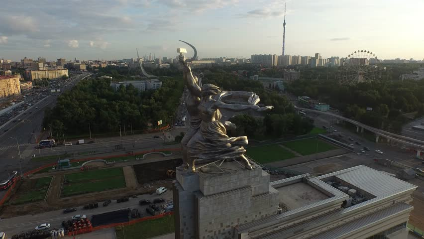 RUSSIA. MOSCOW. JULY 2015: Rabochiy i Kolkhoznitsa (Worker and Kolkhoz Woman) by sculptor Vera Mukhina. Sunset time. HELICOPTER VIEW 5 - 4K stock video clip