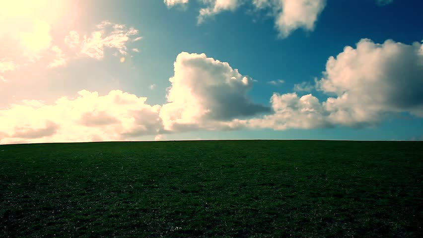 green mountain with blue sky and white clouds passing by, time lapse,mountain landscape - HD stock footage clip