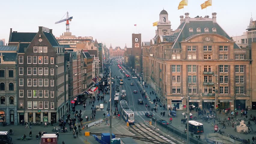 Amsterdam, The Netherlands - May 2015: Busy European City Center With Passing Trams