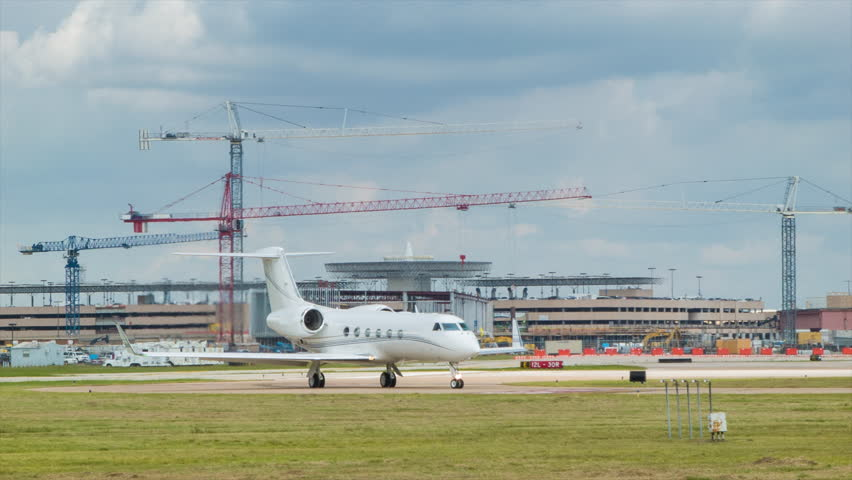 Unmarked Executive Business Jet Airplane at Houston TX Hobby Airport Clean White Plane with No Markings with Expansion Construction in the Background
