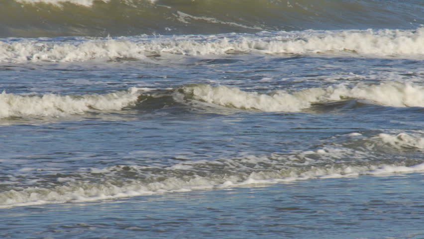 Waves rolling onto beach - HD stock video clip