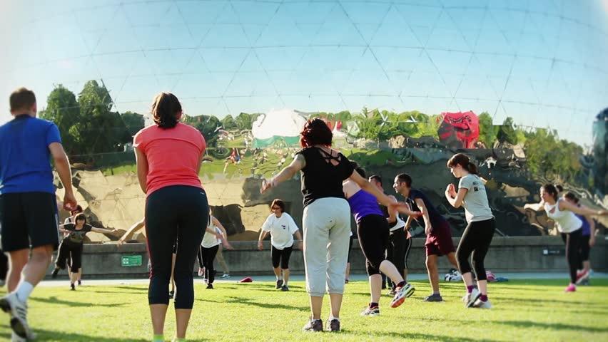 PARIS, FRANCE 9 JULY 2015; Parc de la Villette Fitness Class. Fitness Team training in the Park in front of La Géode cinema. Parc de La Villette, Paris.