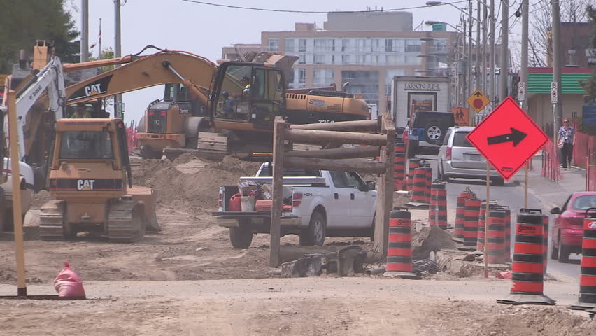 Kitchener, Ontario, Canada - June 2015 Road construction in the summer for new road and transit line. - HD stock video clip