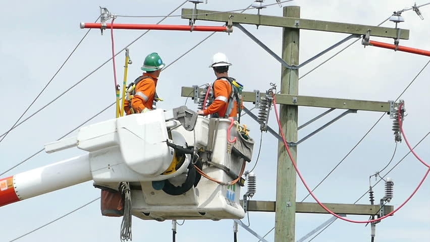 VANCOUVER, BC, CANADA, JULY 2015: A pair of hydro repair linemen work together to resolve various issues on a telephone pole in suburbia in the city of Vancouver. - HD stock video clip