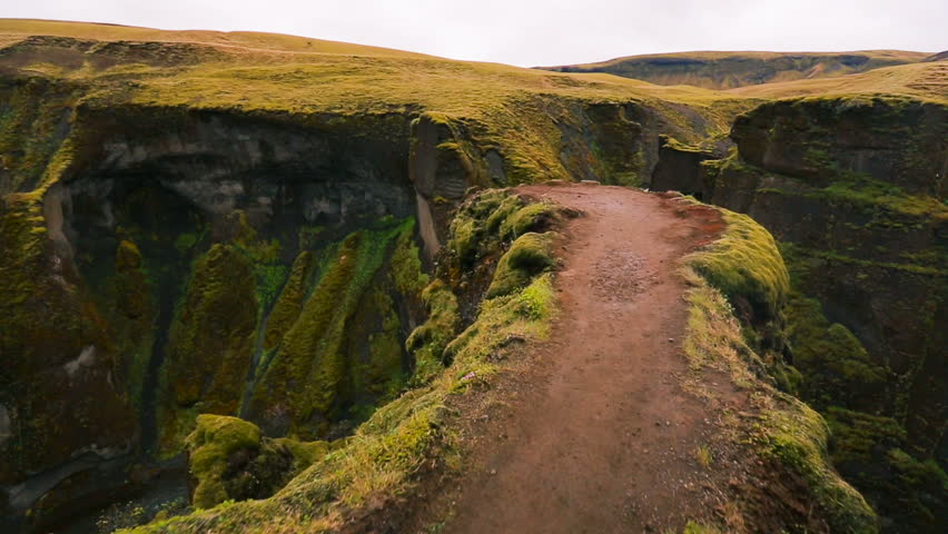Aerial View Through Green Mountain River Canyon in Iceland.