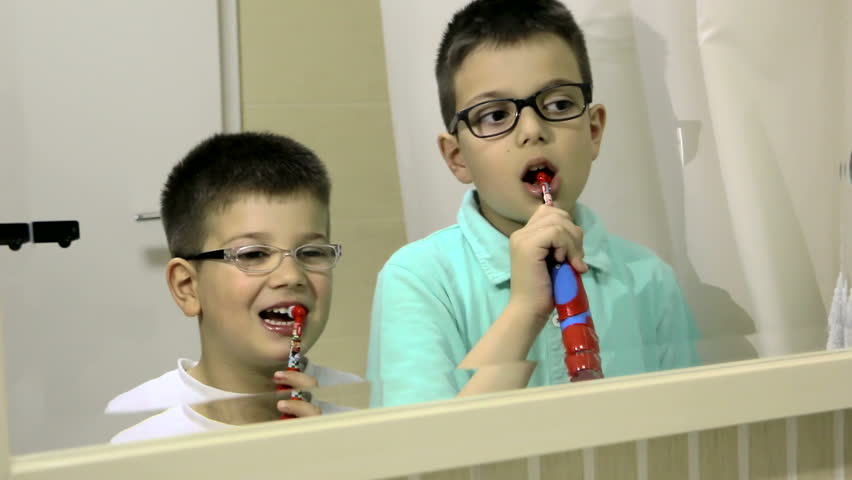 Boys brush their teeth in the bathroom before going to bed - slider shoot - HD stock video clip